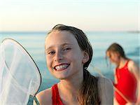 Girls fishing in shallow water Stock Photo - Premium Royalty-Freenull, Code: 649-06432694
