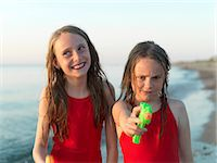 Girls playing on beach together Stock Photo - Premium Royalty-Freenull, Code: 649-06432696