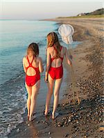 preteen bathing suit - Girls walking on rocky beach Stock Photo - Premium Royalty-Freenull, Code: 649-06432697