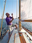 Man adjusting rigging on sailboat Stock Photo - Premium Royalty-Free, Artist: Cultura RM, Code: 649-06432711
