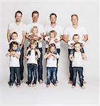 Fathers and children posing together Stock Photo - Premium Royalty-Free, Artist: Blend Images, Code: 649-06432751