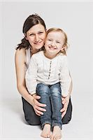 Mother and daughter smiling together Stock Photo - Premium Royalty-Freenull, Code: 649-06432759