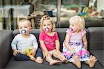 Toddlers sucking on pacifiers together Stock Photo - Premium Royalty-Free, Artist: I. Jonsson, Code: 649-06432772