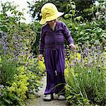 Girl walking in garden outdoors Stock Photo - Premium Royalty-Free, Artist: Aflo Relax, Code: 649-06432807