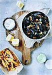 Platter of steamed mussels and fries Stock Photo - Premium Royalty-Free, Artist: Blend Images, Code: 649-06432853