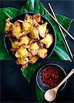Plate of deep fried dumplings with sauce Stock Photo - Premium Royalty-Free, Artist: Photocuisine, Code: 649-06432870