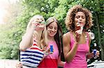 Smiling women blowing bubbles outdoors Stock Photo - Premium Royalty-Free, Artist: Cultura RM, Code: 649-06432955
