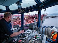 ships at sea - Worker driving tugboat in wheelhouse Stock Photo - Premium Royalty-Freenull, Code: 649-06433066