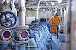 Engineer standing in engine room Stock Photo - Premium Royalty-Free, Artist: Andrew Kolb, Code: 649-06433080