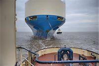 ships at sea - Tugboat pulling ship to harbor Stock Photo - Premium Royalty-Freenull, Code: 649-06433090