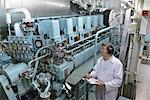 Engineer working in ships engine room Stock Photo - Premium Royalty-Free, Artist: Andrew Kolb, Code: 649-06433098