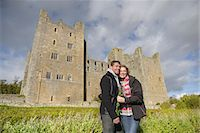 Couple hugging by medieval castle Stock Photo - Premium Royalty-Freenull, Code: 649-06433139