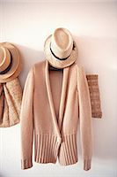 Knitted sweater and hat on hook Stock Photo - Premium Royalty-Freenull, Code: 649-06433210