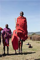 Maasai people walking in grassy field Stock Photo - Premium Royalty-Freenull, Code: 649-06433211