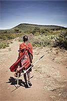 Maasai man walking on dirt road Stock Photo - Premium Royalty-Freenull, Code: 649-06433212