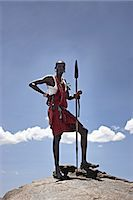 Maasai man standing on top of rock Stock Photo - Premium Royalty-Freenull, Code: 649-06433214