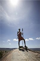 Maasai man standing on top of rock Stock Photo - Premium Royalty-Freenull, Code: 649-06433219