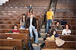 Students lounging in classroom Stock Photo - Premium Royalty-Free, Artist: Blend Images, Code: 649-06433305