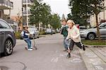 Children playing on suburban street Stock Photo - Premium Royalty-Free, Artist: Jose Luis Stephens, Code: 649-06433344