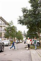 Children playing on suburban street Stock Photo - Premium Royalty-Freenull, Code: 649-06433346