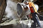 Worker pouring mixture from vat in shop Stock Photo - Premium Royalty-Free, Artist: Westend61, Code: 649-06433452