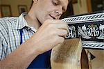 Worker examining weaving in shop Stock Photo - Premium Royalty-Free, Artist: Blend Images, Code: 649-06433453