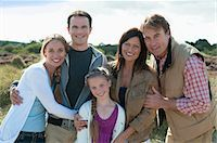 Family smiling together outdoors Stock Photo - Premium Royalty-Freenull, Code: 649-06433468