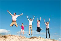 five - Family cheering together on sand dune Stock Photo - Premium Royalty-Freenull, Code: 649-06433488