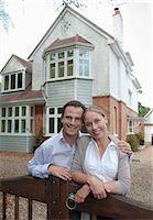 Couple smiling outside house Stock Photo - Premium Royalty-Freenull, Code: 649-06433523