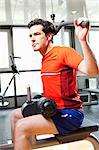 Man using exercise equipment at gym Stock Photo - Premium Royalty-Free, Artist: Blend Images, Code: 649-06433549