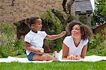 Mother and daughter eating in backyard Stock Photo - Premium Royalty-Free, Artist: Blend Images, Code: 649-06433602