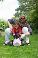 Mother and daughter playing in backyard Stock Photo - Premium Royalty-Freenull, Code: 649-06433630