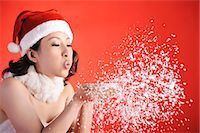 Christmas Girl Blowing Snow Stock Photo - Premium Royalty-Freenull, Code: 6106-06433789