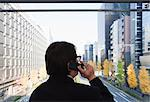Business Man on mobile phone looking at city Stock Photo - Premium Royalty-Free, Artist: Allan Baxter, Code: 6106-06434023