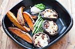 stuffed mushrooms, sweet potato wedges Stock Photo - Premium Royalty-Free, Artist: IIC, Code: 6106-06434210