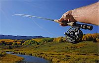 fishing - Man fly fishing mountain stream, POV Stock Photo - Premium Royalty-Freenull, Code: 6106-06434377