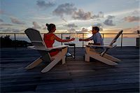 seychelles - Couple drinking champagne front of the sunset Stock Photo - Premium Royalty-Freenull, Code: 6106-06434739