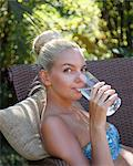 Young lady drinking water closeup Stock Photo - Premium Royalty-Freenull, Code: 6106-06434755