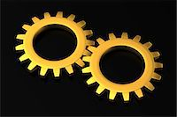 Two Golden Cog Wheels Stock Photo - Premium Royalty-Freenull, Code: 6106-06434857