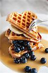 Waffels with golden syrup and blue berries Stock Photo - Premium Royalty-Freenull, Code: 6106-06434971