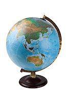 Close-up of globe over white background Stock Photo - Premium Royalty-Freenull, Code: 693-06435802