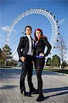 Portrait of confident young business couple standing together against London Eye, London, UK Stock Photo - Premium Royalty-Free, Artist: Robert Harding Images, Code: 693-06435875