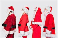 People in Santa costume standing in row against gray background Stock Photo - Premium Royalty-Freenull, Code: 693-06435898