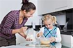 Happy mother and daughter baking together in kitchen Stock Photo - Premium Royalty-Free, Artist: Photocuisine, Code: 693-06435977