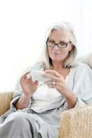 Senior Woman Using Smart Phone Stock Photo - Premium Royalty-Freenull, Code: 618-06436491