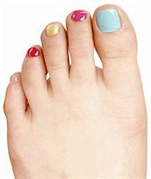 female feet close up - A female foot with multicolored toe nail polish Stock Photo - Premium Royalty-Freenull, Code: 618-06436570