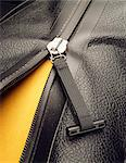 A zipper opening a black leather bag Stock Photo - Premium Royalty-Free, Artist: Natasha V, Code: 618-06436609