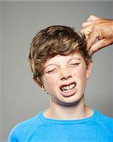teenage boy having hair pulled Stock Photo - Premium Royalty-Freenull, Code: 618-06436619