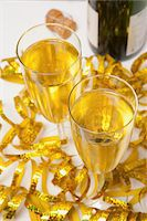 Two Glasses of Sparkling Wine and Streamers Stock Photo - Premium Royalty-Freenull, Code: 600-06438861