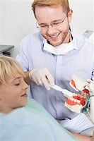 Dentist demonstrating to Boy how to Brush Teeth during Appointment, Germany Stock Photo - Premium Royalty-Freenull, Code: 600-06438914